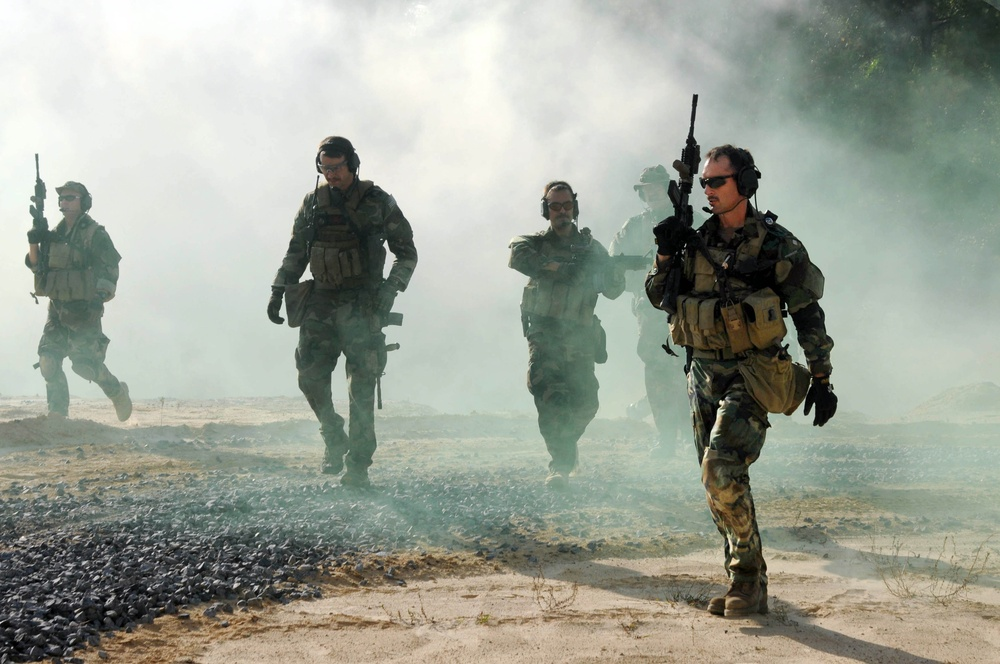 Navy SEALs conduct immediate action drills at the John C. Stennis Space Center.
